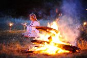 picture of covenant  - Ukrainian girl with a wreath of flowers on her head against a background of fire - JPG