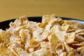 picture of cereal bowl  - Black bowl with breakfast cereal flakes  - JPG