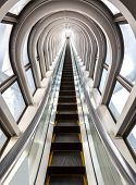 pic of escalator  - perspective escalators stairway inside contemporary blue glass business centre - JPG