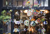 foto of chimes  - Colorful glass wind chime hanging outside - JPG
