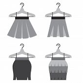 stock photo of mini-skirt  - Set Of Black Women Skirts With Hangers On White Background Vector Illustration - JPG