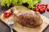 stock photo of thighs  - Marinated grilled chicken thigh BBQ on a wooden board - JPG