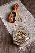 picture of peppercorns  - White peppercorns in a glass jar on burlap - JPG