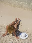 picture of shipwreck  - Woman relaxing on the famous Shipwreck Navagio beach in Zakynthos Greece - JPG
