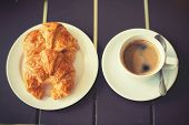picture of breakfast  - Croissant Breakfast served with black coffee and a breakfast menu such as orange juice jam eggs filling it - JPG