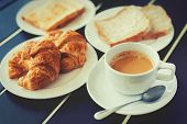 pic of breakfast  - Croissant Breakfast served with black coffee and a breakfast menu - JPG
