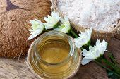 picture of massage oil  - Coconut oil essential oil from nature a skin care that safe rich vintamin use in massage at spa organic cosmetic on wooden background - JPG
