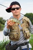 image of fishermen  - Young fisherman on the river bank - JPG