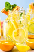 foto of infusion  - Infused water with fresh citrus fruits and ice. ** Note: Shallow depth of field - JPG