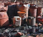 pic of day judgement  - Group of old rusty barrels with toxic chemical waste - JPG