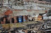 stock photo of day judgement  - Group of old rusty barrels with toxic chemical waste - JPG