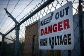 picture of chain link fence  - A warning sign on a barbed wire chain - JPG