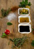 picture of vinegar  - Dressing ingredients on a rustic wooden background - JPG