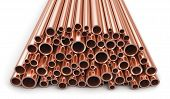 stock photo of copper  - Heap of shiny metal copper pipes isolated on white background - JPG