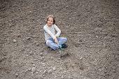 image of hoe  - Girl digging in organic soil by hoe - JPG