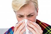 pic of blowing nose  - Sick blonde woman blowing her nose on white background - JPG