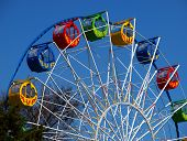 stock photo of ferris-wheel  - Ferris wheel in the spring amusement park awaits visitors