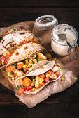 picture of sandwich wrap  - Tortilla wrap sandwich with fried chicken and vegetablesselective focus - JPG