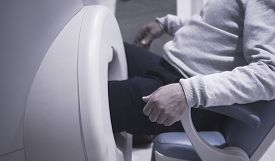 stock photo of magnetic resonance imaging  - Patient in fully open high field Magnetic Resonance Image MRI scanner CAT scan scanning knee and leg - JPG