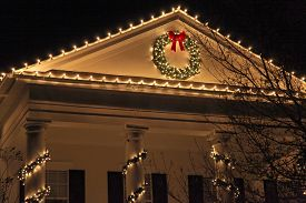 picture of roof-light  - The top of a house with Christmas lights - JPG
