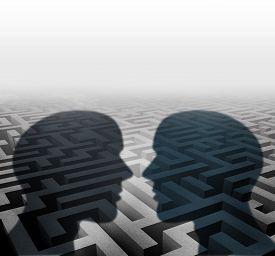 stock photo of counseling  - Relationship concept for group therapy or marriage counseling or employee relations as two human head shadows on a maze facing together as an icon of partnership solutions and personal crisis management - JPG