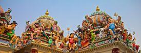 image of hindu  - Hindu deity on the roof of the Sri Mariamman hindu temple in Singapore - JPG