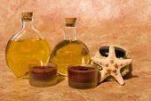 stock photo of massage oil  - Essential body massage oils in bottles - JPG
