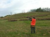 picture of ringneck  - young man taking aim on a covey of quail - JPG