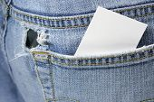 stock photo of debit card  - Blank card in back pocket of torn jeans - JPG