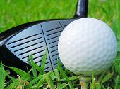 stock photo of dimples  - Golf ball on tee with club - JPG