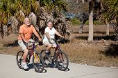 Happy senior couple gets in shape riding their bicycles.