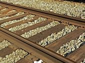 picture of amtrak  - angled rail road tracks on a gravel bed - JPG