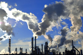 stock photo of fuel economy  - industrial site with smoking pipes global warming concept - JPG