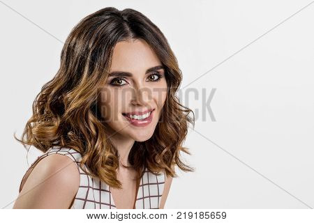 poster of Woman dark brunette long hair, curly hair. Fashion girl with healthy long wavy hairstyle. Beauty brunette woman portrait. Copy space