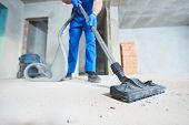 construction cleaning service. dust removal with vacuum cleaner poster