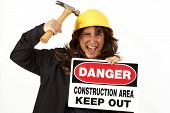 Woman Hitting Hard Hat With Hammer poster