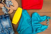 Set Of Beachwear On Wooden Background poster