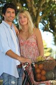 stock photo of farmers market vegetables  - lovely smiling couple back from market - JPG