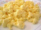 pic of scrambled eggs  - A delicious plate of scrambled eggs on a white background - JPG