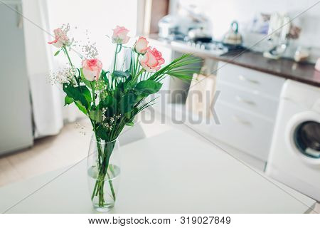 poster of Bouquet Of Roses On Kitchen. Modern Kitchen Design. Interior Of Kitchen Decorated With Flowers.