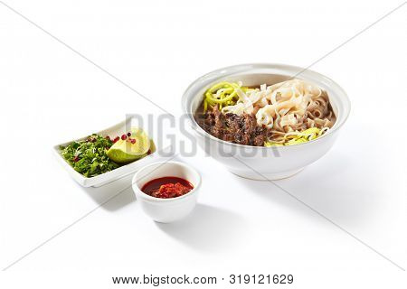 poster of Traditional Vietnamese soup Pho Bo with beef meat, rice noodles, sturdy broth and a set of hot spice