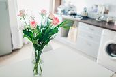 Bouquet Of Roses On Kitchen. Modern Kitchen Design. Interior Of Kitchen Decorated With Flowers. poster