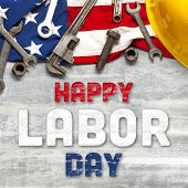 US American flag with work tools on worn white wooden background. For USA Labor day celebration. Wit poster