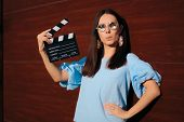 Cool Actress Holding Movie Clapper Ready To Film poster