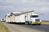 stock photo of oversize load  - Transporting portable homes  - JPG