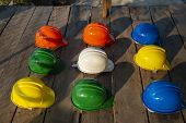 Safety Helmet (hard Hat) For Safety And Health Officer,engineer Or Architect Place On Old Wooden Flo poster