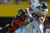 VIENNA, AUSTRIA - JULY 16 RB Laurent Marceline   (#28 France) is tackled at the Football World Champ