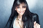 image of straight jacket  - smiling blue eyes young woman with healthy and shiny long hair in black leather jacket - JPG