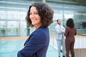 Confident Cheerful Businesswoman. Side View Of Professional Middle Aged Businesswoman Standing With  poster