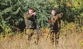 Hunters Gamekeepers Looking For Animal Or Bird. Hunting With Friends. Hunters Friends Enjoy Leisure. poster